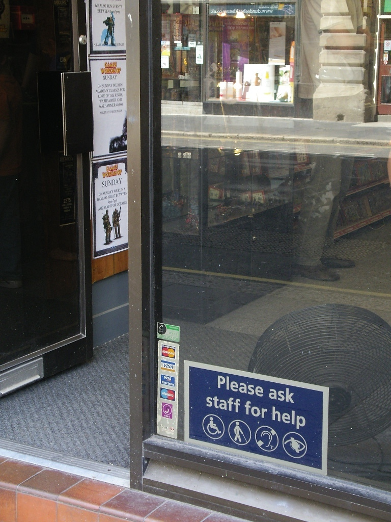 Sign for Diabled Person on Small, Small Store