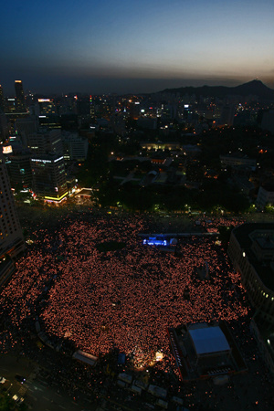 Scenes from candlelight protests in Seoul.