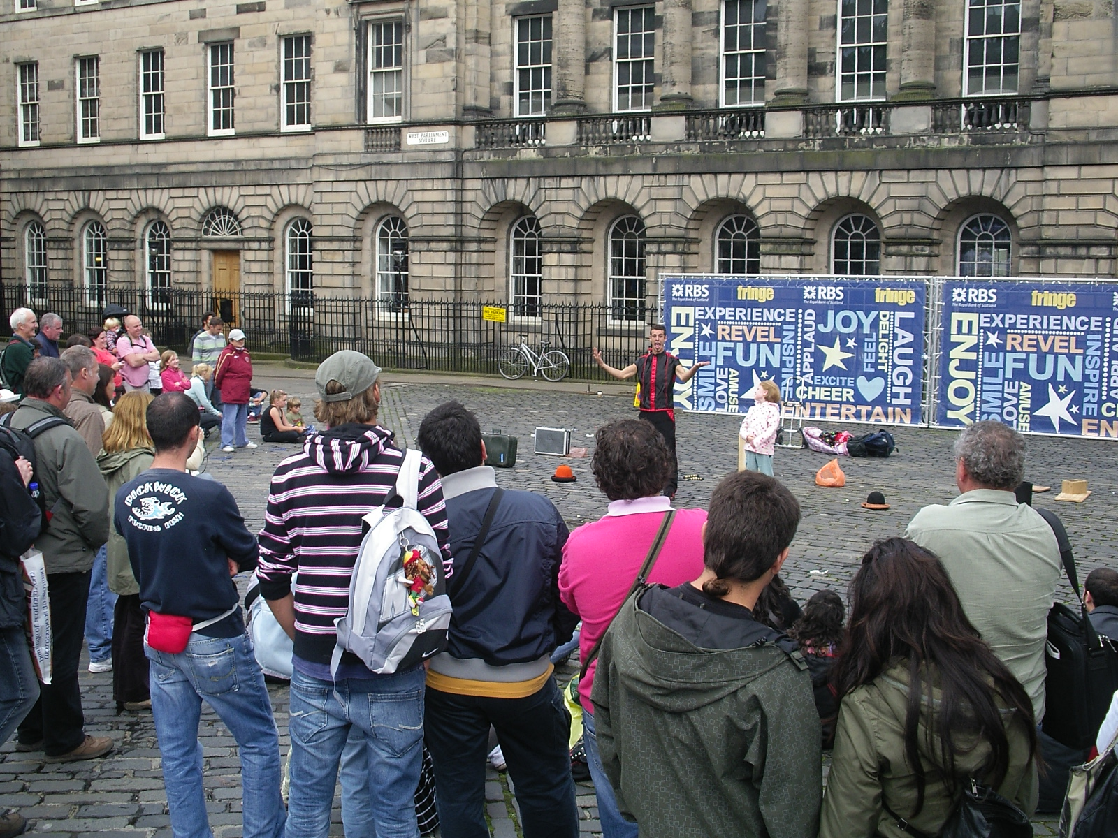 Street performance at a city square, Edinburgh, in Fringe Festival
