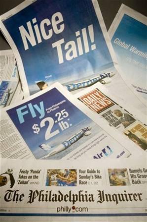 신문에 등장한 항공사 광고 <AP>